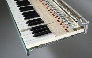 Key action pada kawai MP11 dengan menggunakan tuts key dengan pivot point sama panjang dengan grand piano